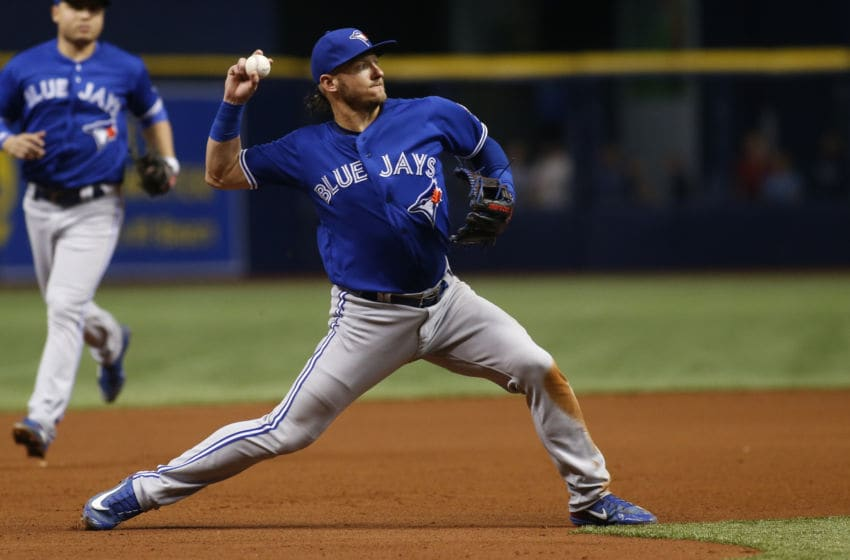 ST. PETERSBURG, FL - MAY 5: Third baseman Josh 唐纳森 #20 of the Toronto Blue Jays fields the ground out 通过  Johnny Field of the Tampa Bay Rays during the fourth inning of a game on May 5, 2018 at Tropicana Field in St. Petersburg, Florida. (Photo 通过  Brian Blanco/Getty Images)