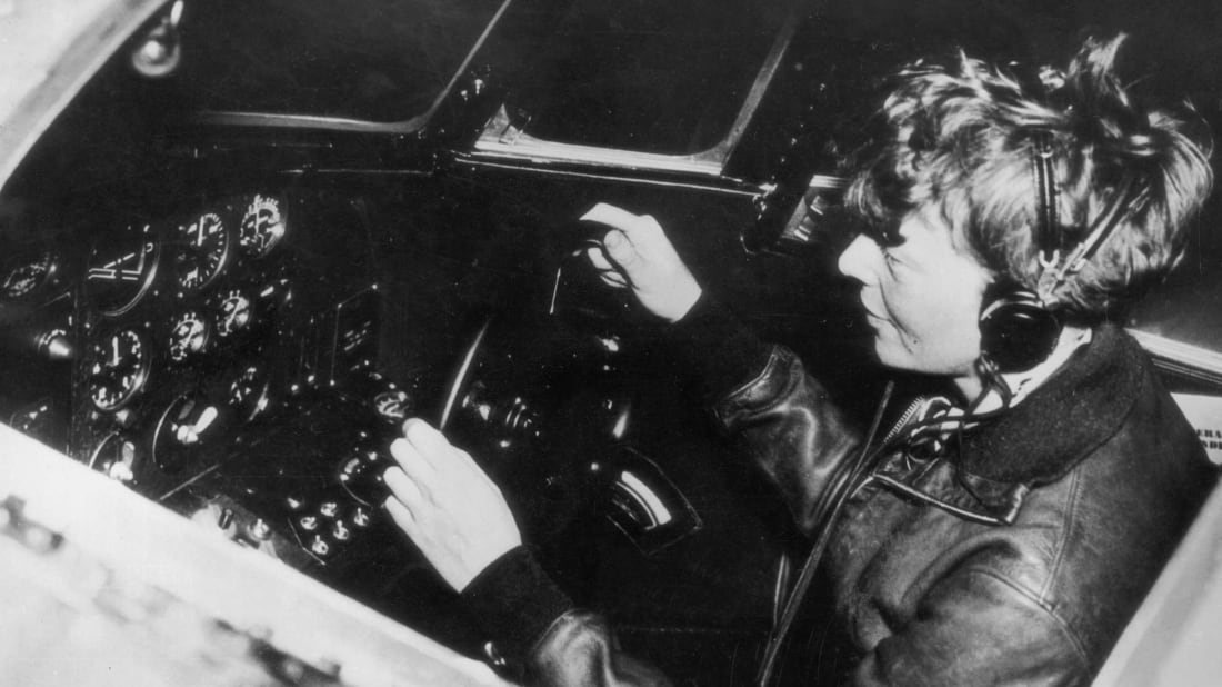 Amelia Earhart operating the controls of a flying laboratory in 1935.