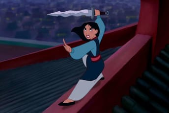 Mulan faces off against a menacing Hun during the climax of Disney's Mulan (1998).