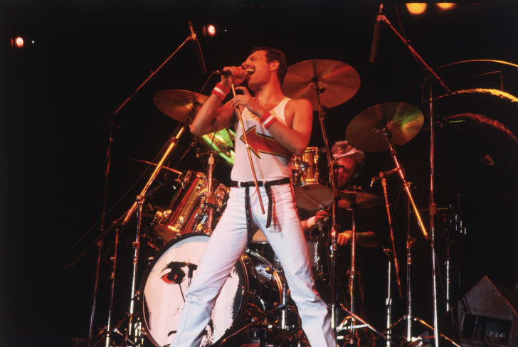 Freddie Mercury (1946 - 1991), lead singer of 70s hard rock quartet Queen, in concert in Milton Keynes in 1982