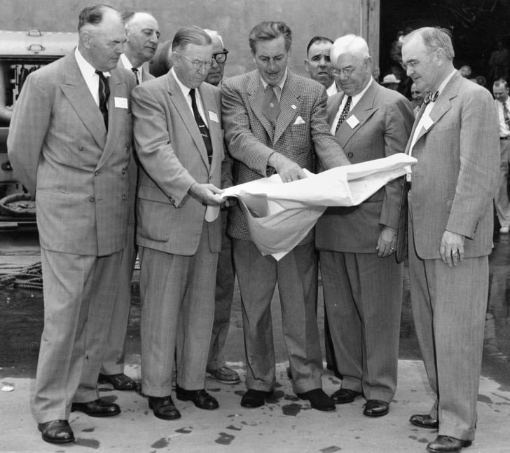 Walt Disney shows Disneyland plans to Orange County officials in December 1954.