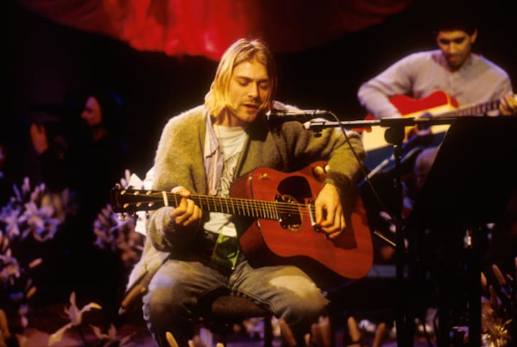 A photo of Kurt Cobain performing with Nirvana.