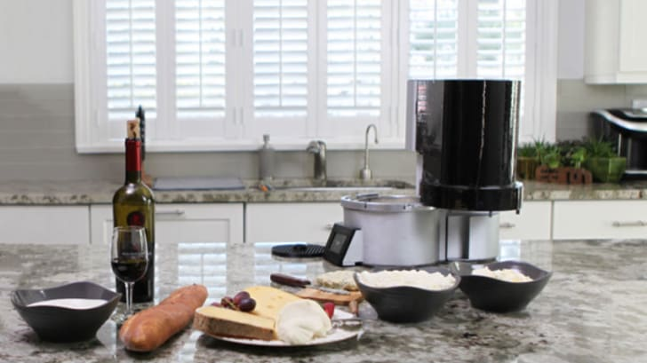 A Fromaggio cheesemaker on a countertop
