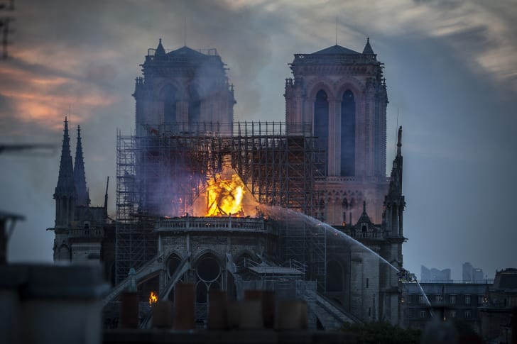 French firefighters work to extinguish the flames at Notre-Dame Cathedral. Here, the spire has already collapsed, but the main stone structure and bell towers were saved.