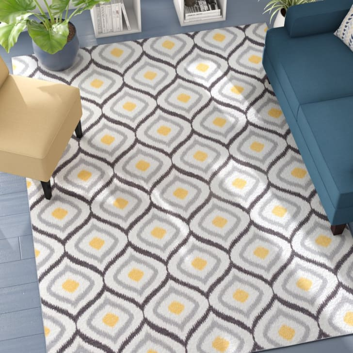 A patterned area rug in a living room