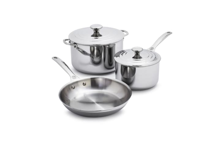 A stainless steel pot, saucepan, and skillet