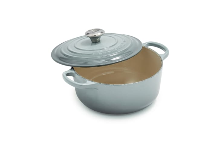 A round Le Creuset Dutch oven in light blue