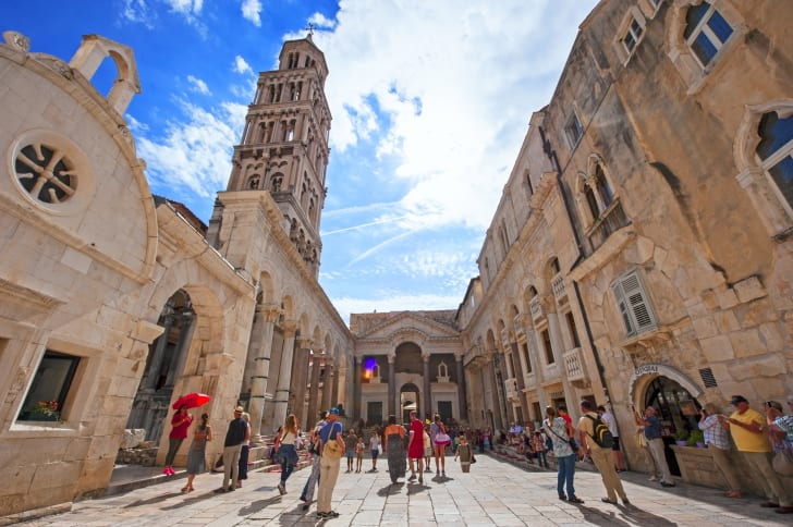 Tourists wander around outside Diocletian's Palace.