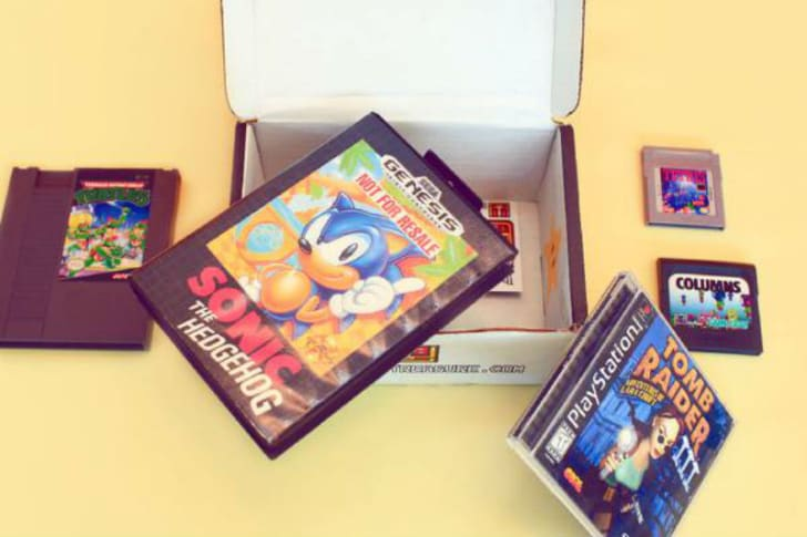 An open Retro Game Treasure subscription box