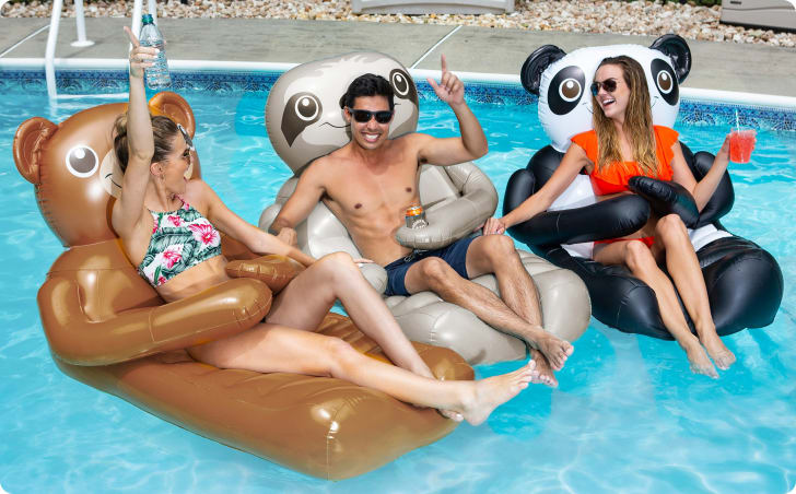 People relax in pool floats shaped like a panda, a sloth, and a teddy bear