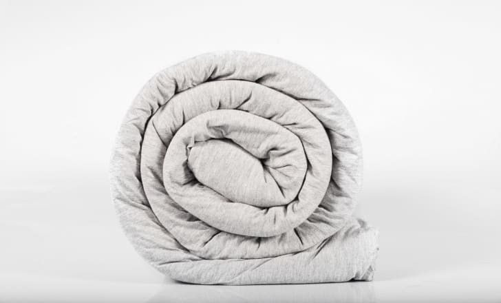 Rolled up weighted blanket.