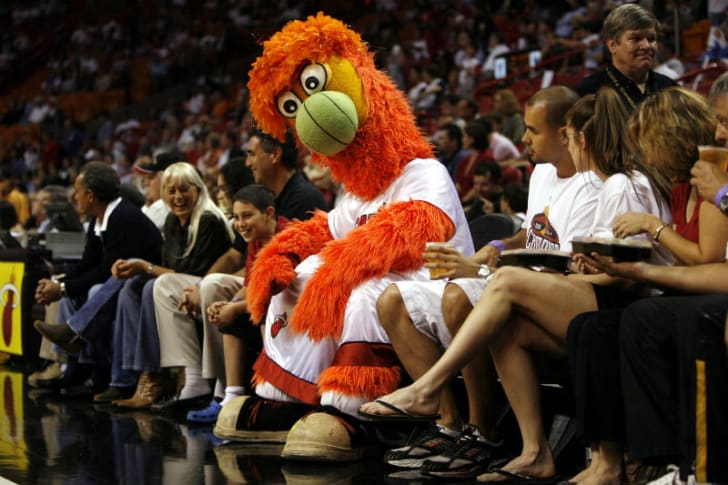 Burnie sits down during a Miami Heat game
