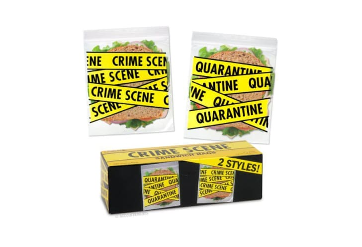 "Plastic baggies with yellow ""crime scene tape"" printed on them"