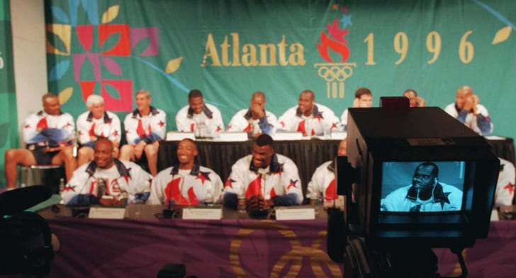 Shaquille O'Neal is shown on a TV monitor as the U.S. Olympic basketball team is introduced during a press conference in 1996.