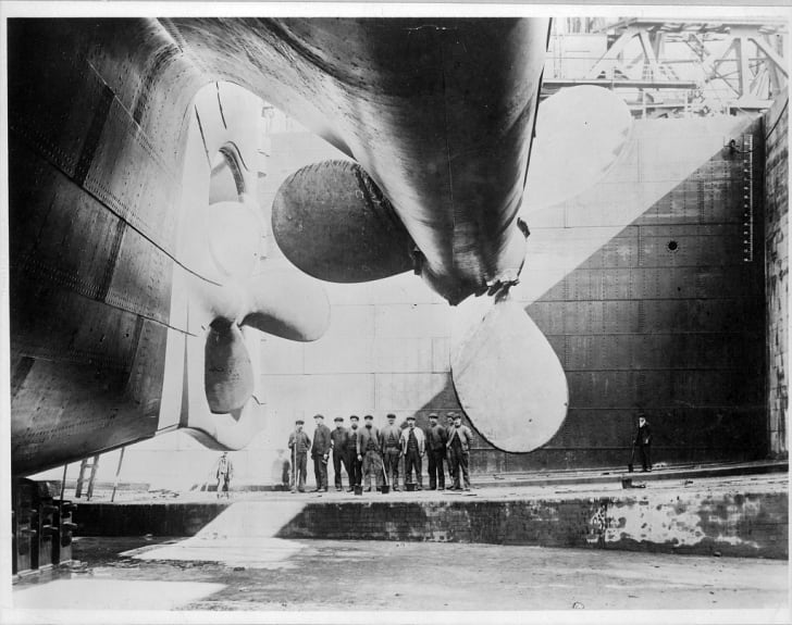 View of the Titanic's propellers with a group of men