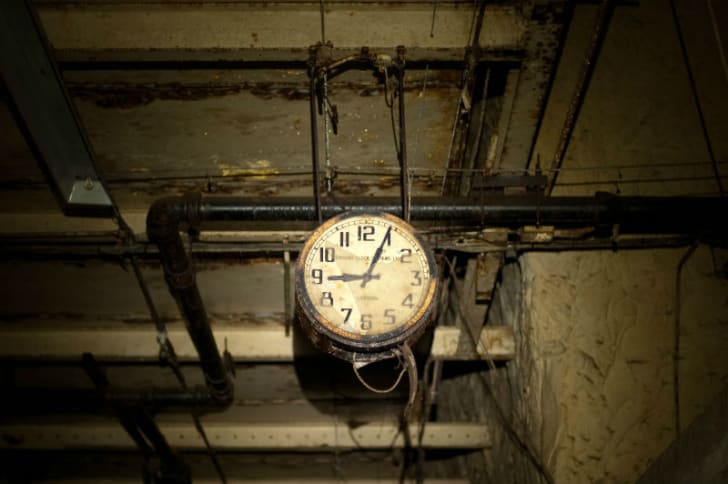 A clock hangs inside the Drakelow Tunnels