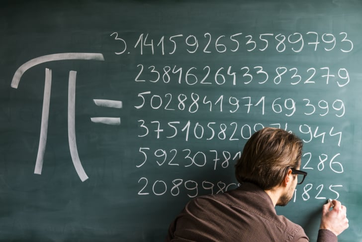 Professor writes out the full number Pi on a chalkboard