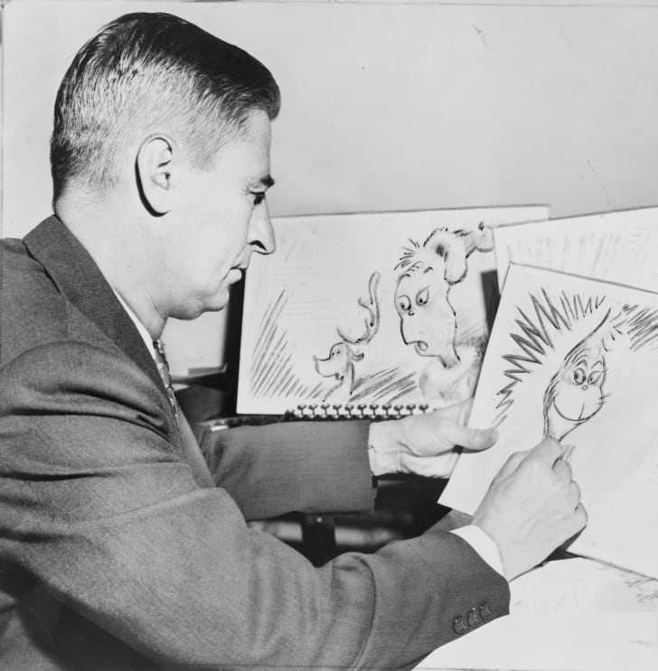 "Ted Geisel, American writer and cartoonist, at work on a drawing of the grinch for ""How the Grinch Stole Christmas"""