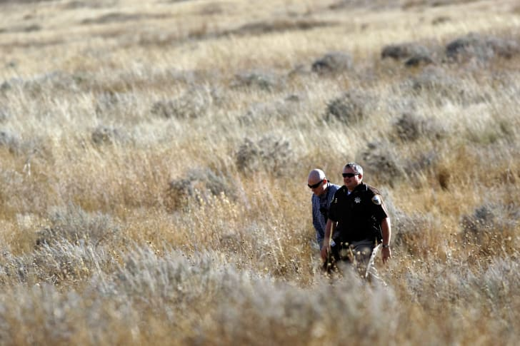 sheriff's deputies seach a field for Falcon Heene before learning he had been found October 15, 2009 southeast of Ft. Collins, Colorado