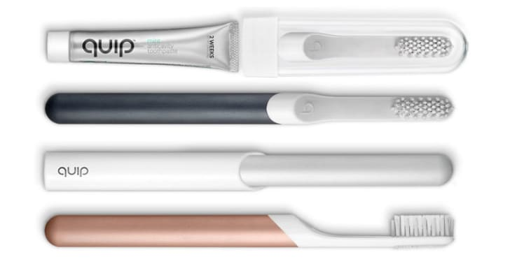 Several quip electric toothbrushes