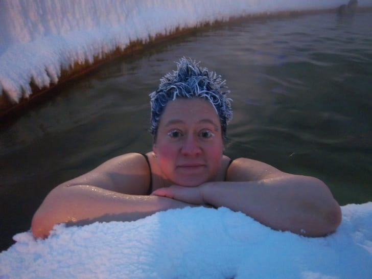 Person in hot tub with frozen hair.