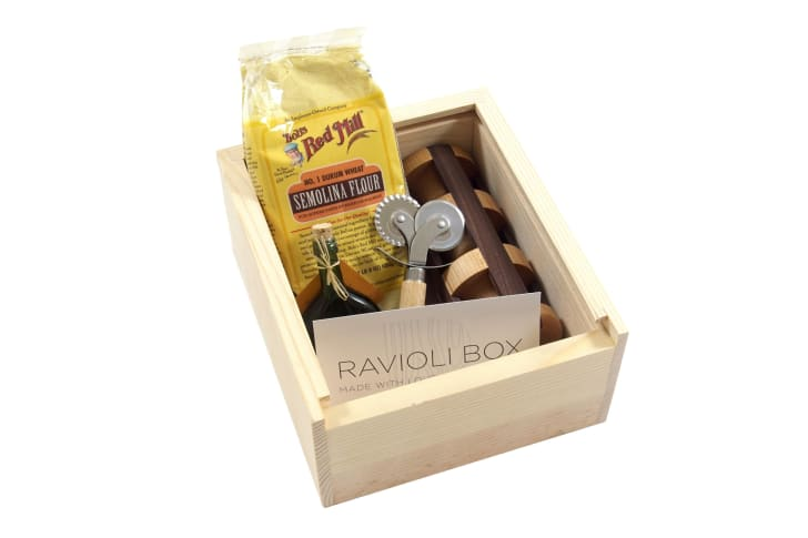 A ravioli-making kit in a wooden box