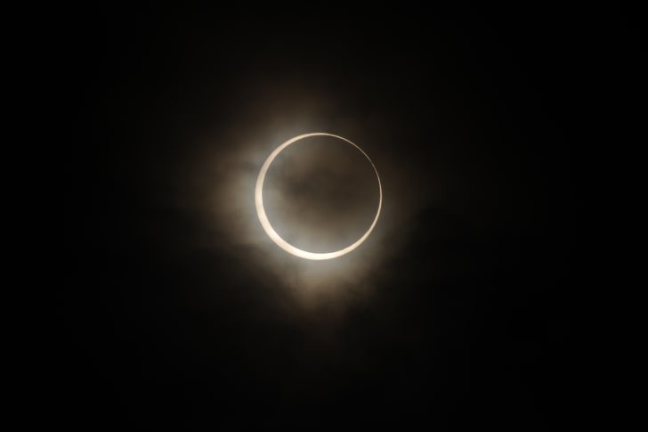 Moon covering sun during solar eclipse.