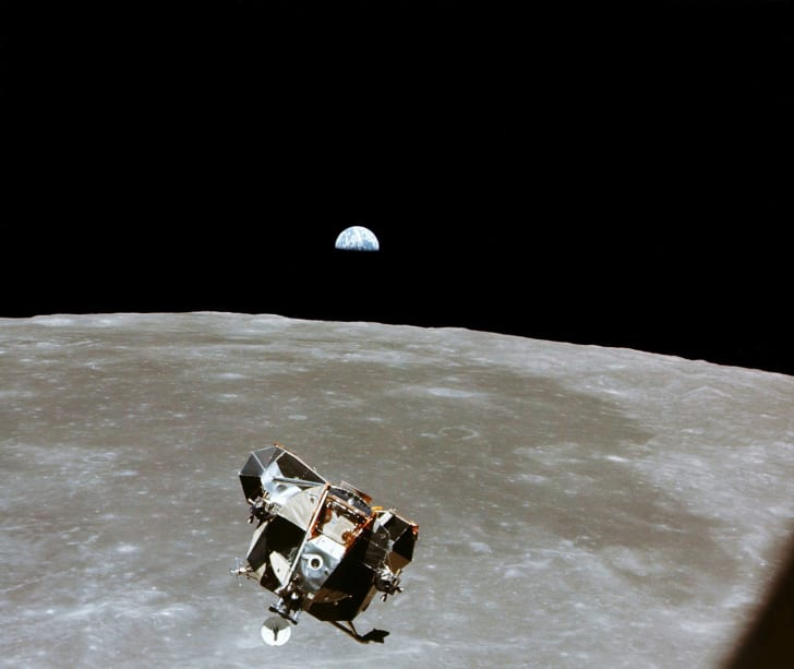 Lunar module over moon's surface.