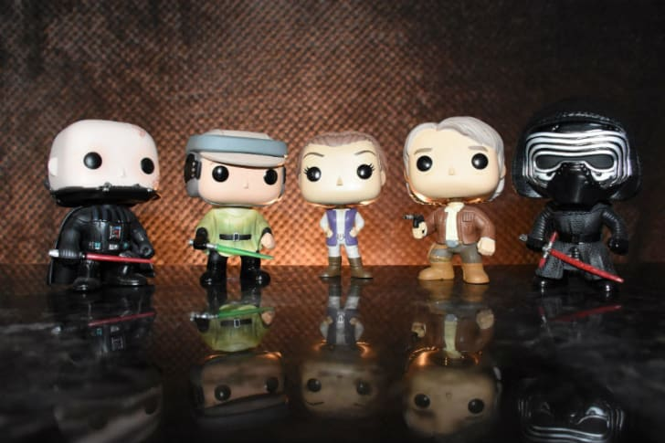 Several Funko 'Star Wars' figures are lined up for a photo