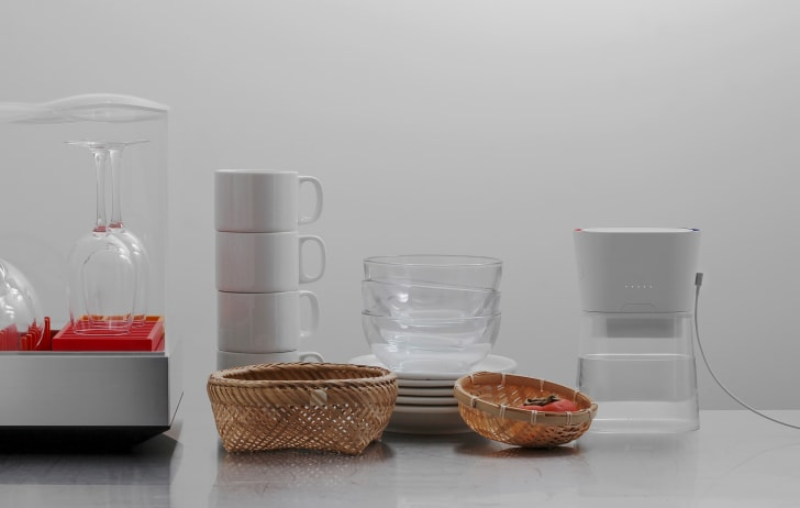 A Duo carafe on a counter with dishware
