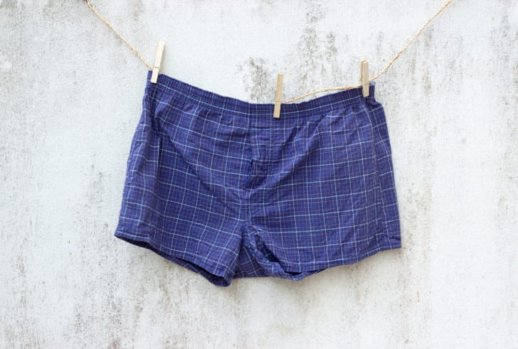 Blue boxer shorts hanging on a line drying