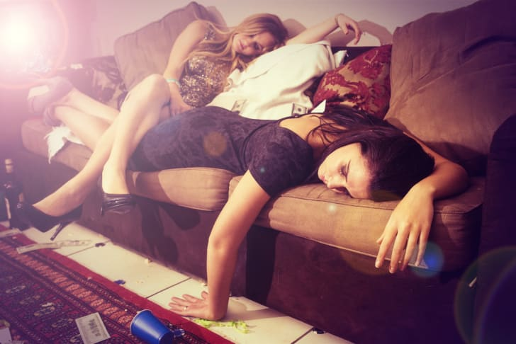 Two young women passed out after partying too hard