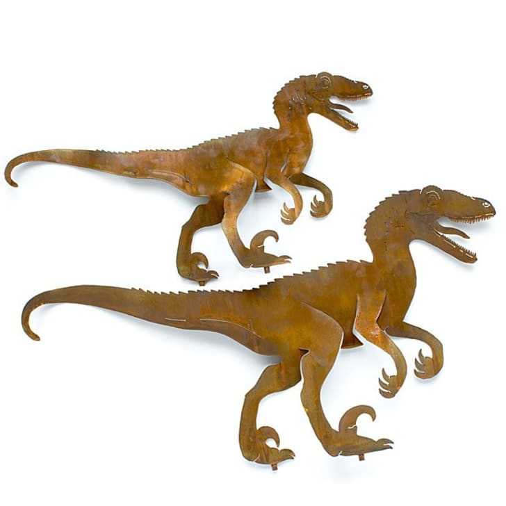 An image of two metal raptor sculptures.