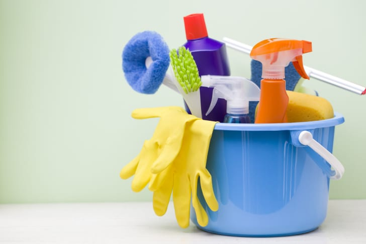 A bucket of cleaning supplies and rubber gloves
