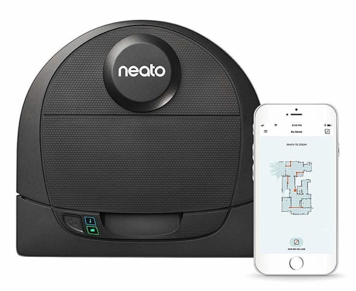 A Neato robotic vacuum and a smartphone open to the Neato home-mapping app