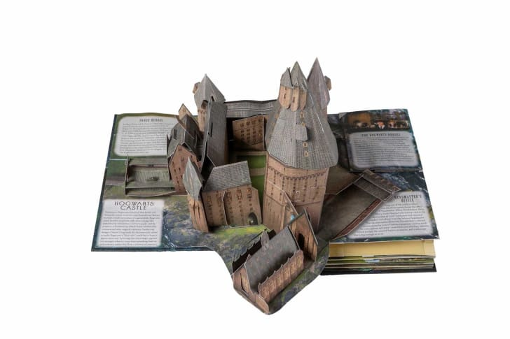 A pop-up book unfolded to reveal a model of Hogwarts