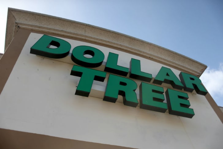 The exterior of a Dollar Tree store is shown from a low angle
