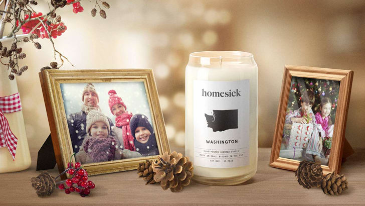 One of Homesick's Washington candles next to family photos