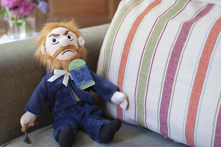 A Vincent Van Gogh doll sitting on a couch