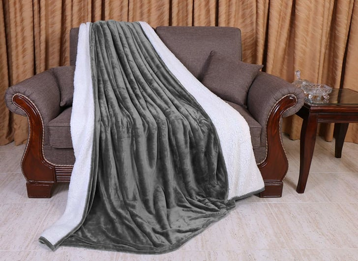 A gray blanket draped over an armchair