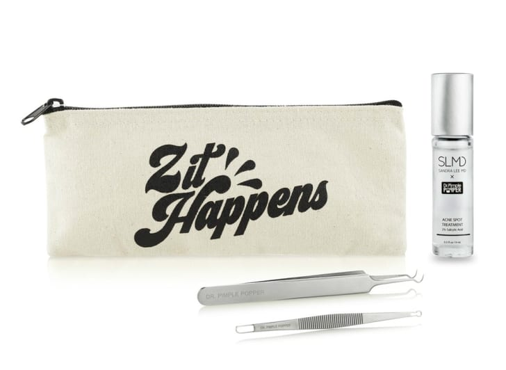 """An image of a canvas bag with """"Zit Happens"""" on it, as well as two pimple popping tools."""