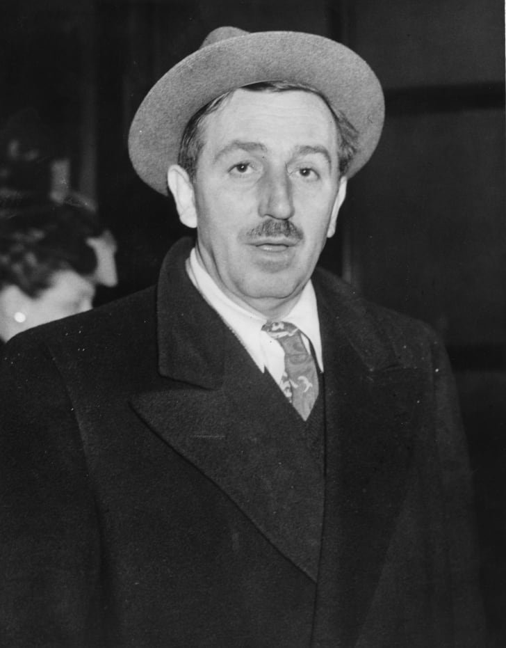 Cartoonist and film producer Walt Disney (1901 - 1966) arriving in the foyer of a London hotel