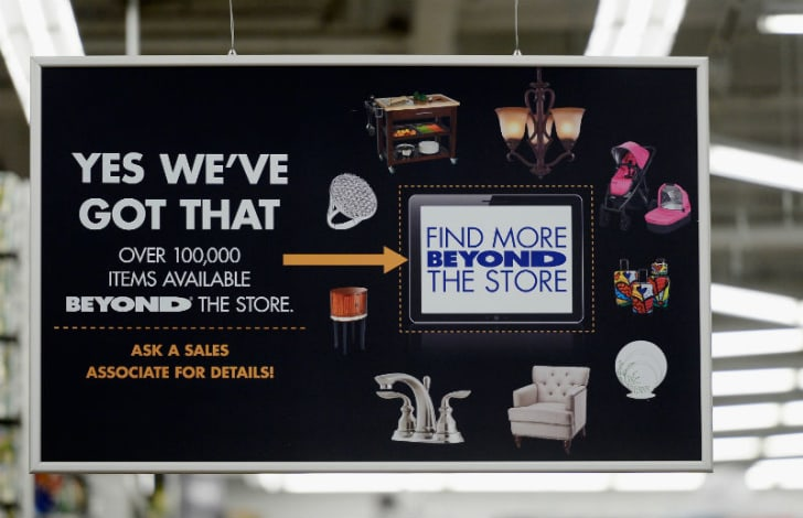 A Bed Bath & Beyond sign is displayed in the store