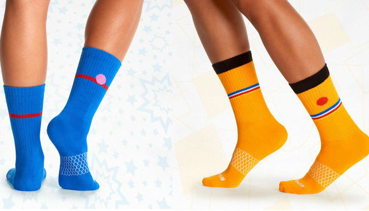 Two pairs of legs wearing Bert and Grover socks