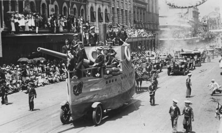 H.M.S. Vindictive float on Peace Celebration Day, Brisbane, 1918. The young men on the float are wearing navy uniforms.
