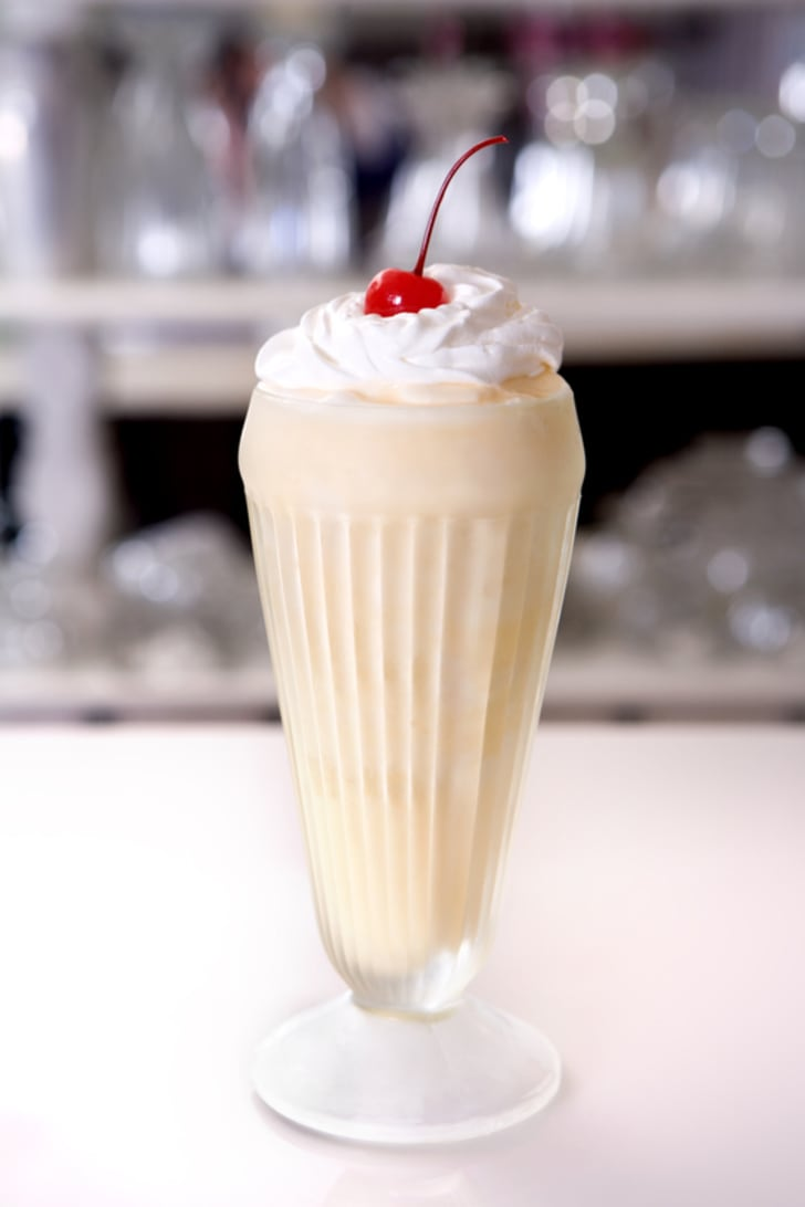 Milkshake in nostalgic glass with whipped cream and cherry on top