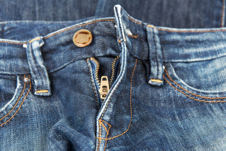 A stuck zipper on a pair of jeans