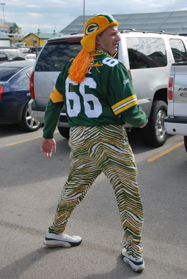 A man attends a sporting event wearing Zubaz pants