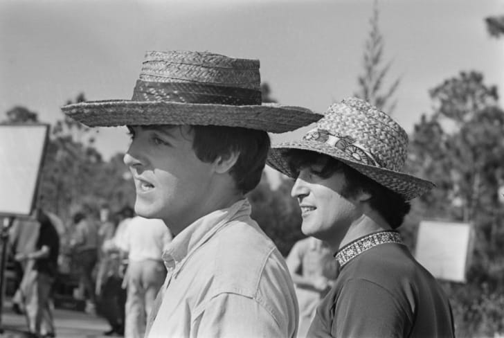 Paul McCartney (left) and John Lennon (1940-1980) of the Beatles pictured together during production and filming of the British musical comedy film Help! on New Providence Island in the Bahamas on 2nd March 1965