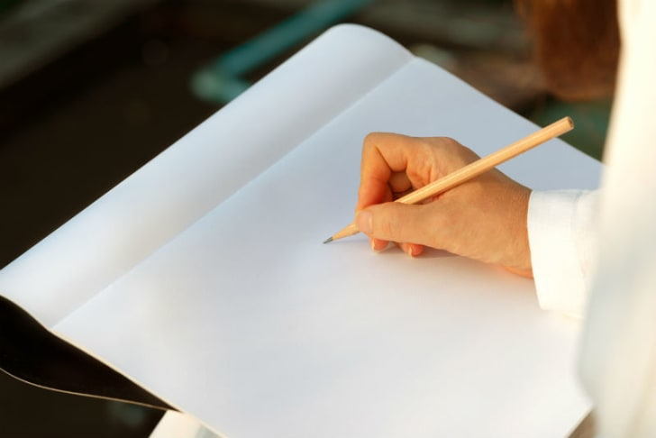 An artist sketches using a pencil